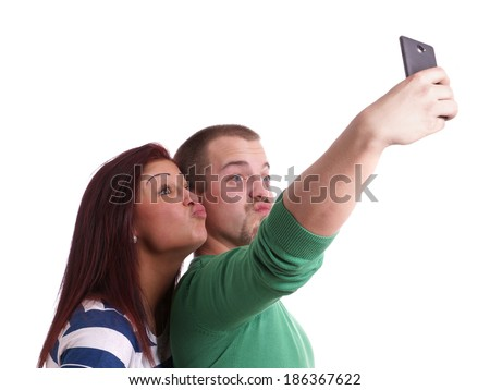 young people making silly duck face while taking a self portrait with smart phone - stock photo