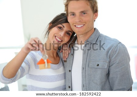 Young people moving in new home - stock photo