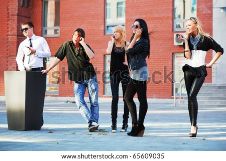 Young people on the phones. - stock photo