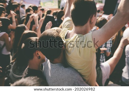 young people on the rock concert,motion blur - stock photo