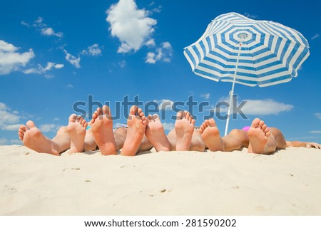 young people on the sandy  beach - stock photo
