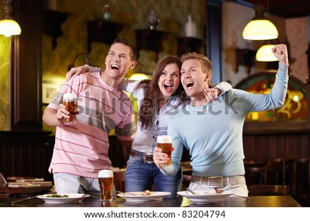 Young people rejoice at the pub - stock photo