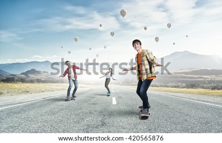 Young people riding skateboard - stock photo
