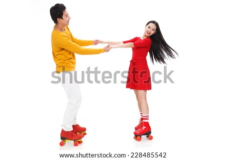 Young people roller skating - stock photo