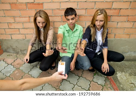 Young people show a stop sign smoking - stock photo