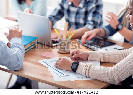Young people sitting at the table - stock photo