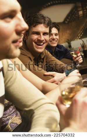 Young people sitting in bar - stock photo