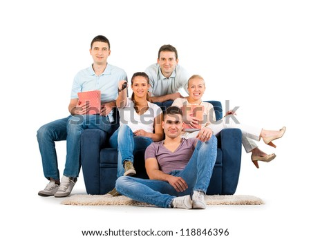 Young people sitting on a sofa smiling, on white background - stock photo