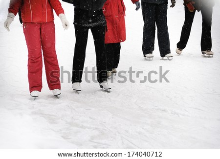 young  people  skating in winter park - stock photo