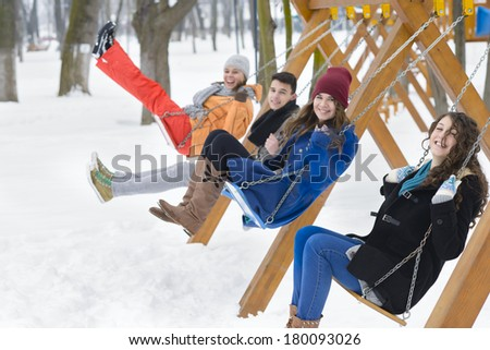Young people swinging in a park - stock photo