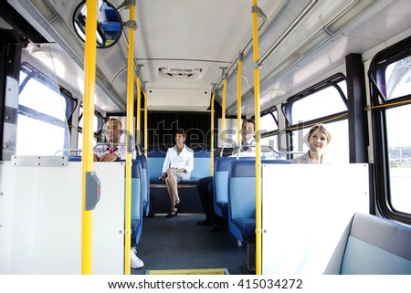 young people taking bus to work. Urban public transportation concept - stock photo
