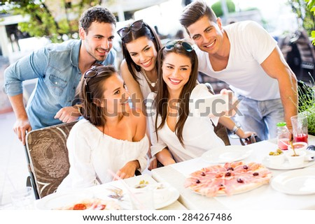 Young people taking photo by the table - stock photo