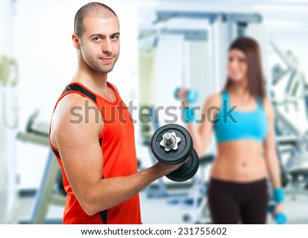 Young people training in a gym - stock photo