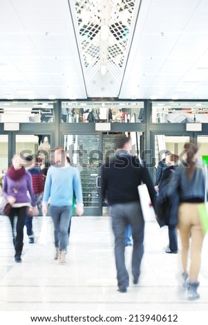 young people walking in office building - stock photo