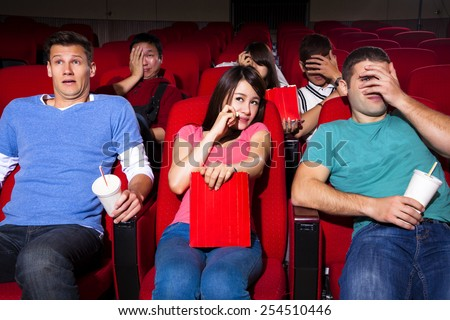 Young people  watching a movie at the cinema - stock photo