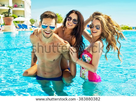 Young People Wear Sunglasses And Having Fun In Swimming Pool - stock photo