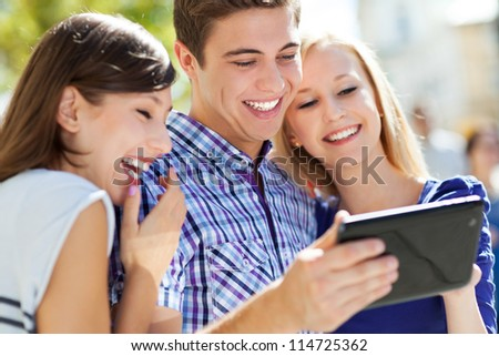 Young people with digital tablet - stock photo