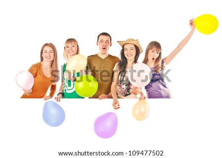 Young people with multi-colored balloons behind the white blank