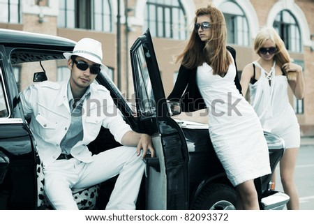 Young people with retro car - stock photo