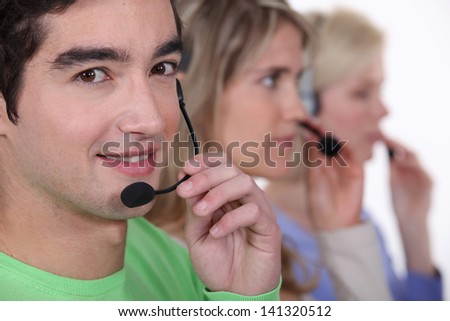 Young people with telephone headsets - stock photo