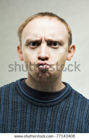 Young perplexed real man - stock photo