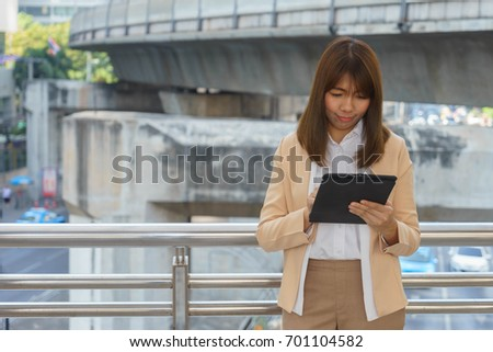 Young person is reading an e-reader.