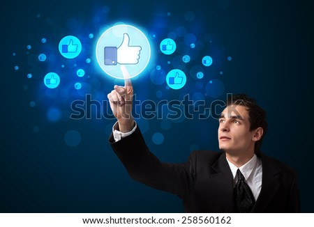 Young person pressing thumbs up button on modern social network system