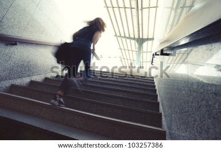 young person running up the stairs - stock photo