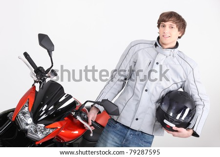 Young person with motorbike - stock photo