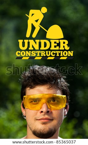 Young persons head looking at construction signs