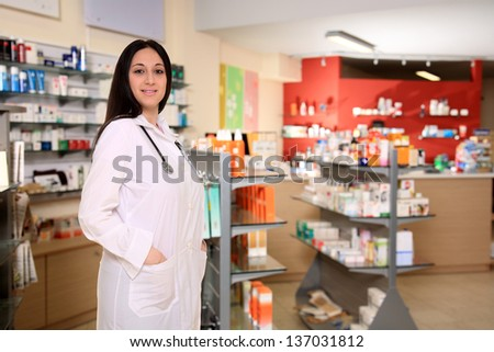 young pharmacist with stethoscope in the pharmacy