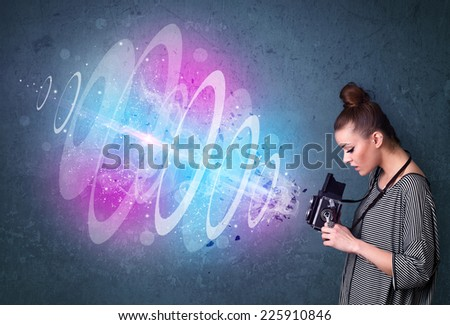 Young photographer girl making photos with powerful light beam