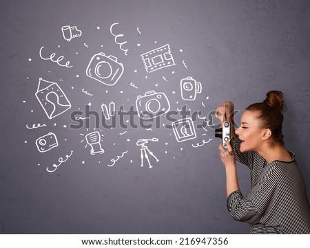 Young photographer girl shooting photography icons - stock photo