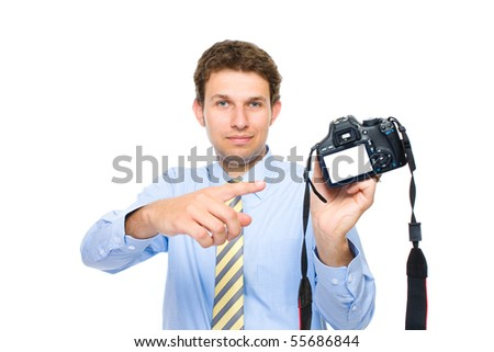 young photographer points to empty, blank dslr camera back screen, studio shoot isolated on white background - stock photo
