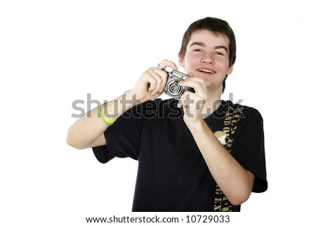 Young photographer taking a photo with retro slr camera