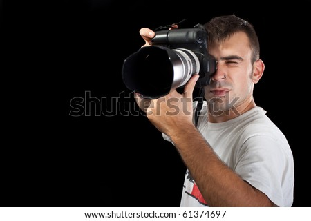 young photographer taking a shot - stock photo