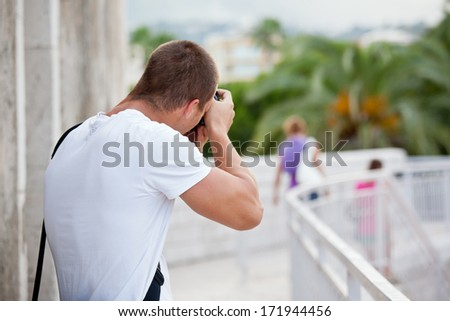 young photographer taknig a photo - stock photo