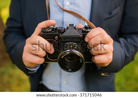 Young photographer with camera in his hands