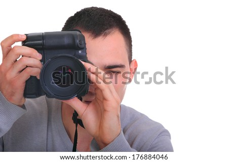 Young photographer with camera, isolated on white - stock photo