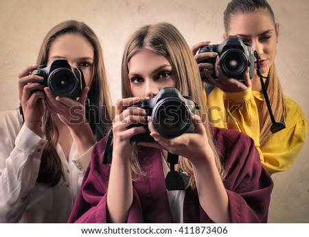 Young photographers - stock photo
