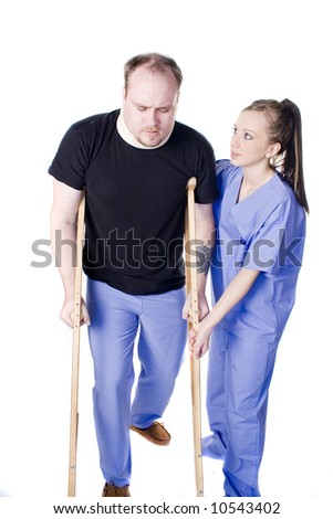 Young physical therapist helping injured man with crutches - stock photo