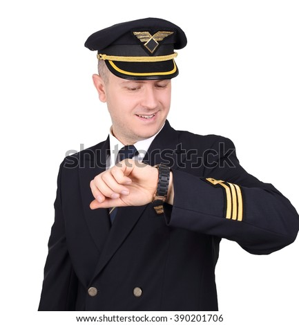 young pilot of the aircraft looks at his watch