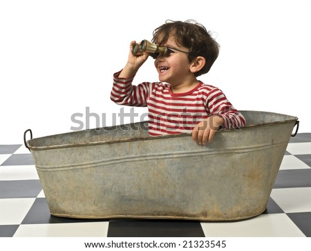 young pirate in an old bathtub with binoculars - stock photo