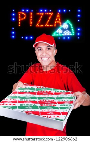 young pizza delivery man with the pizza neon sign - stock photo
