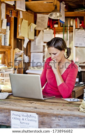 Young plant nursery business owner - stock photo
