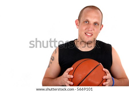 Young Playa A young man with bright blue eyes and a basketball smiling! Isolated over white!
