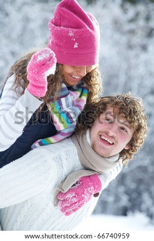 young playful couple has a fun winter time in a snow park - stock photo