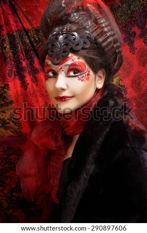 Young plump woman in creative image  in russian style  with artistic red and white visage   - stock photo