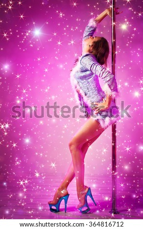 Young pole dance woman in snow princess clothing on pink background with shining stars - stock photo