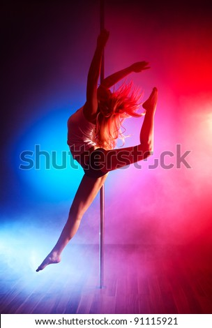 Young pole dance woman jumping. - stock photo